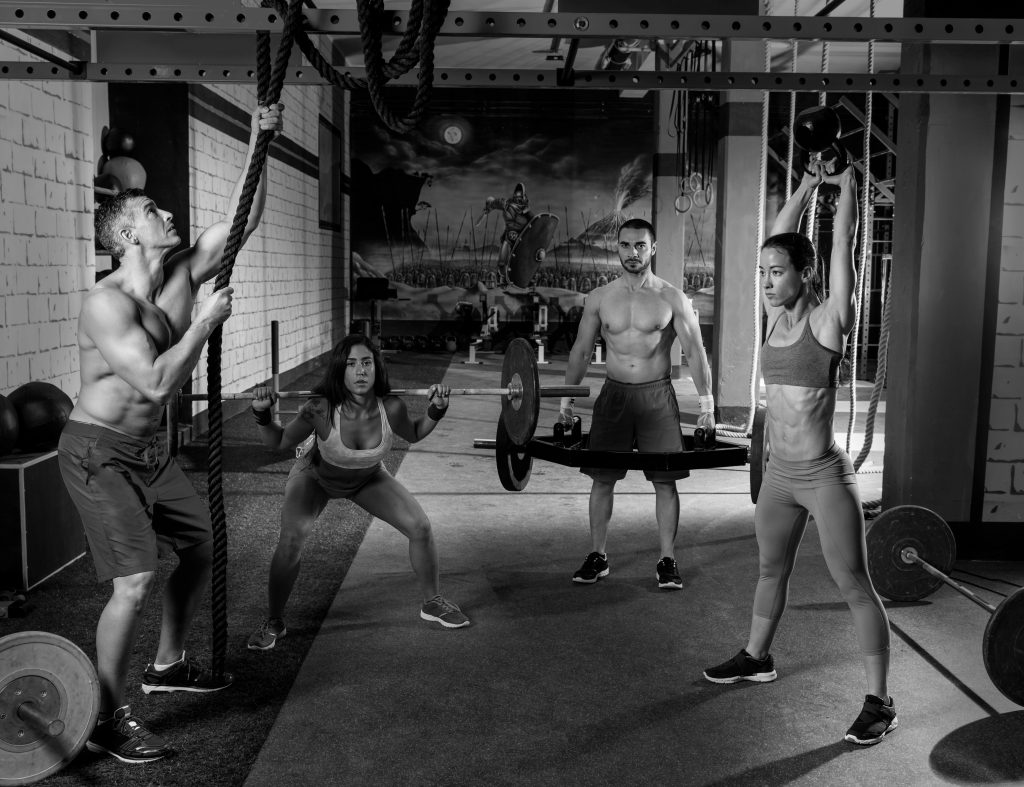 gym group weightlifting workout men and girls